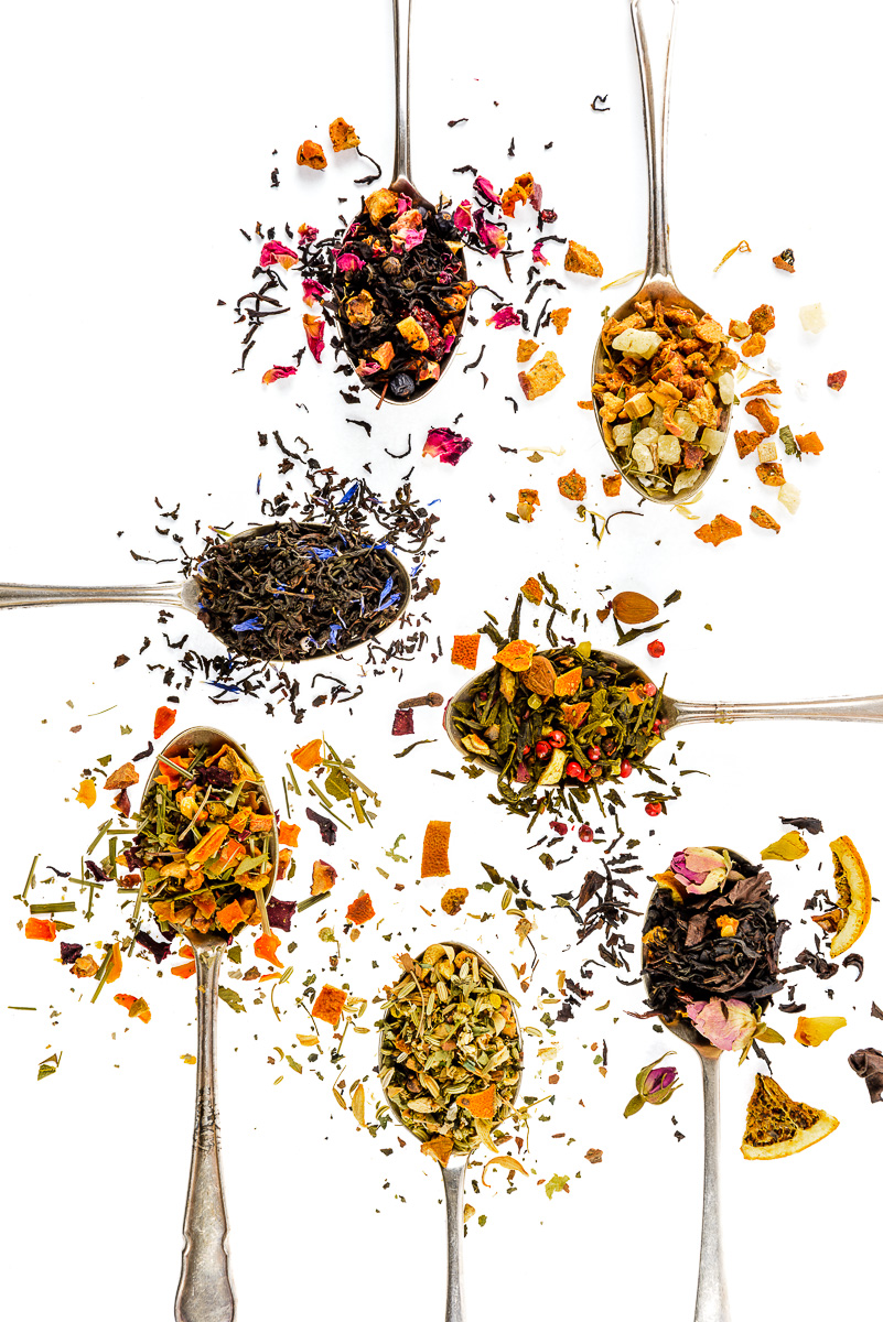 Simpli Special Teas - flat lay, tea mixture on old spoons on white background. Photography by Sue Todd Photography.